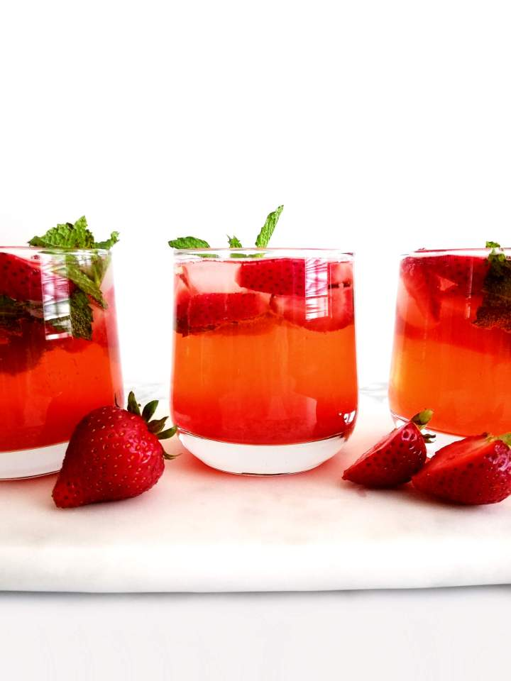 strawberry cooler in glass side view