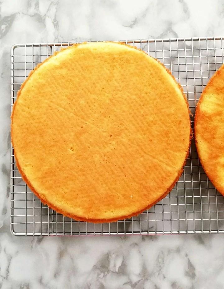 strawberry shortcake cake sponge cake on wire rack overhead image