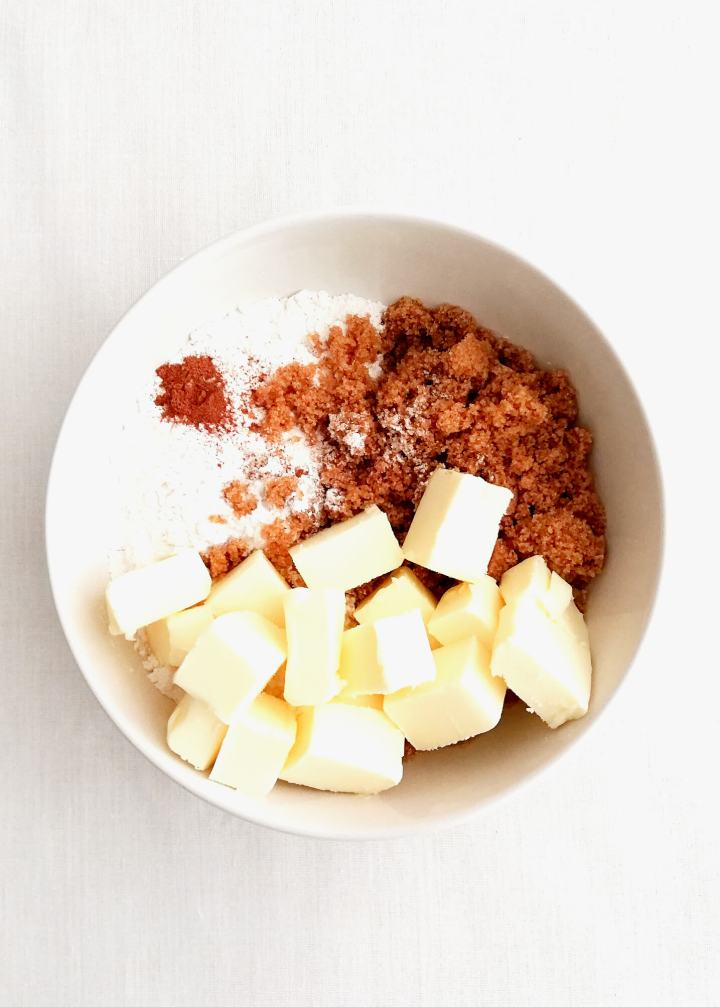 streusel topping ingredients combined in bowl overhead image