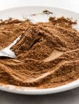 pumpkin pie spice in plate side view close up