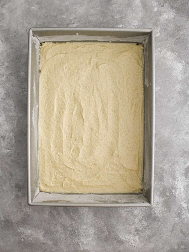 apple cake batter spread in cake pan