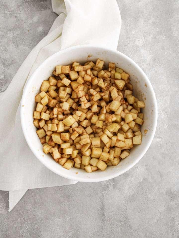 apple cake diced apple in bowl