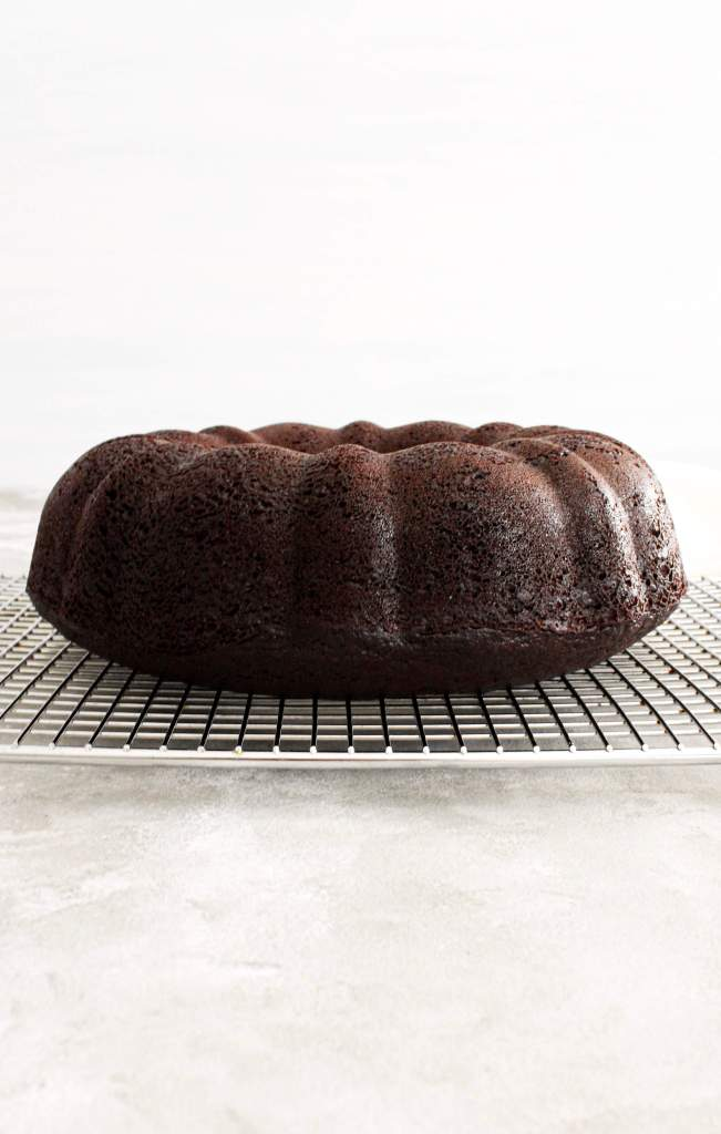 baked chocolate bundt cake on rack head on view