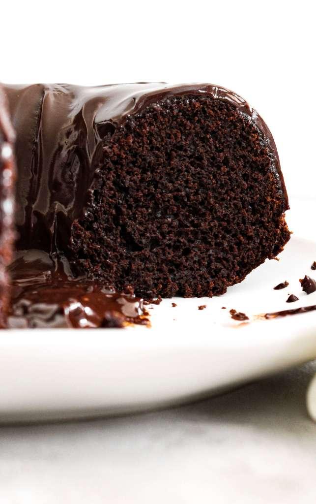 chocolate bundt cake topped with chocolate ganache inside slice view