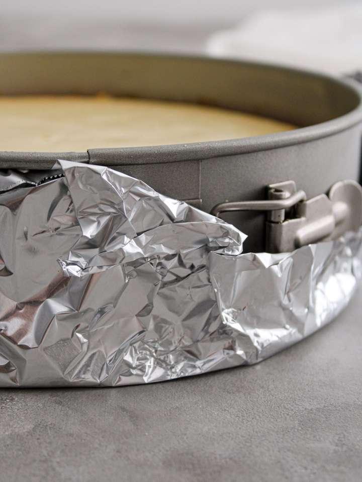 classic cheesecake aluminum foil wraped around bottom of pan