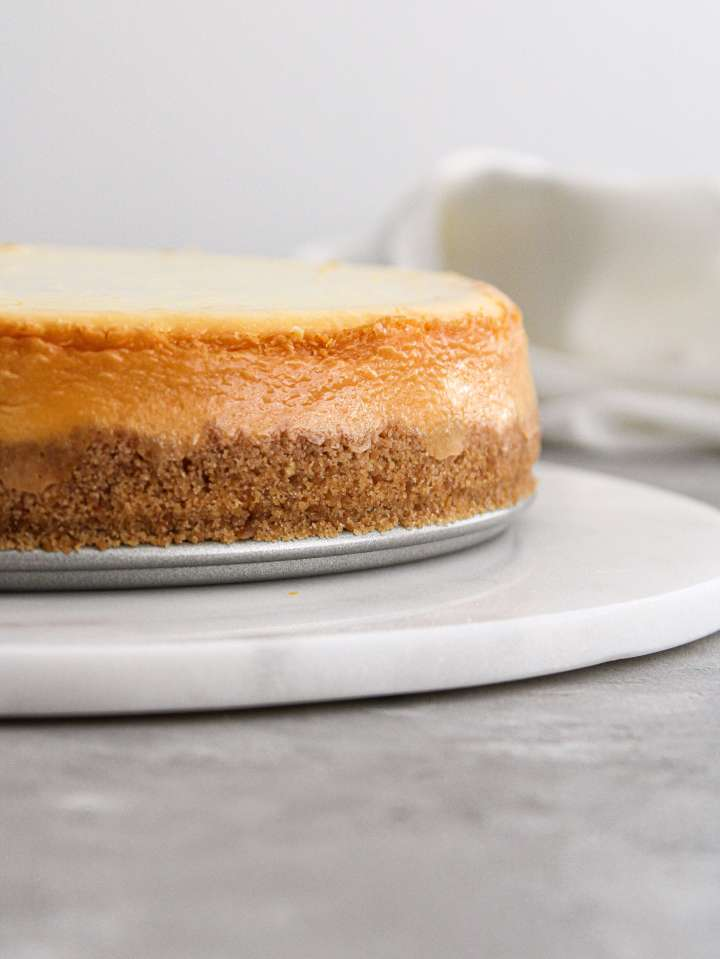 classic cheesecake on serving platter side image close up