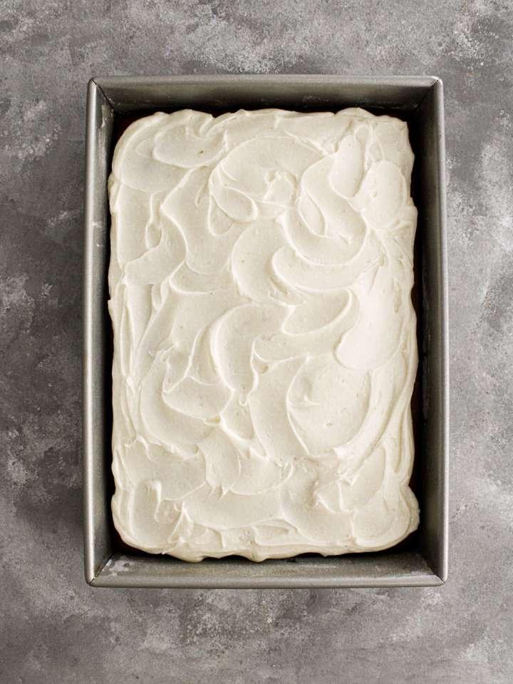 pumpkin sheet cake frosted in pan