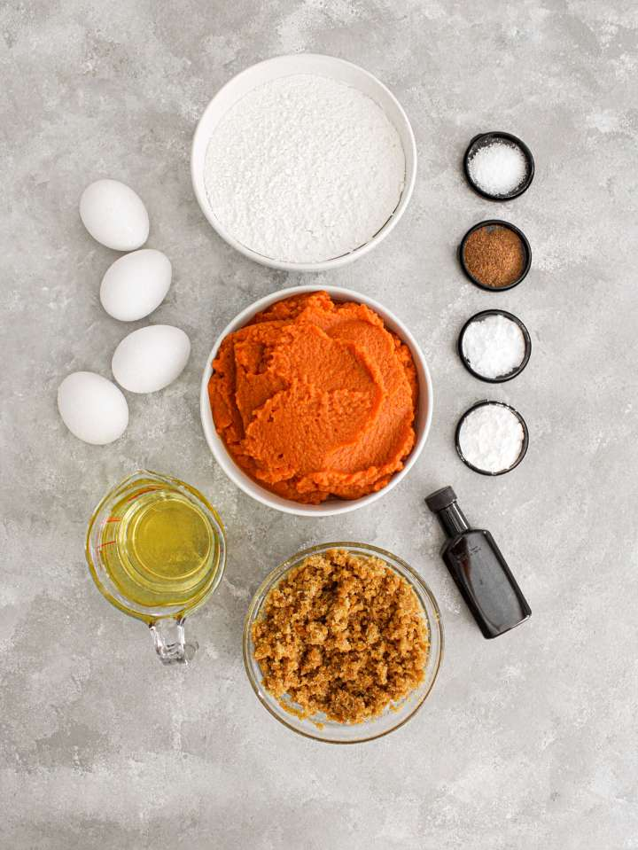 pumpkin sheet cake ingredients portioned into bowls overhead image