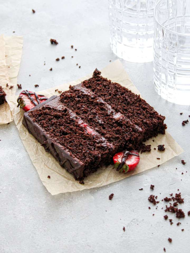 chocolate covered strawberry cake slice on parchment plate (1)