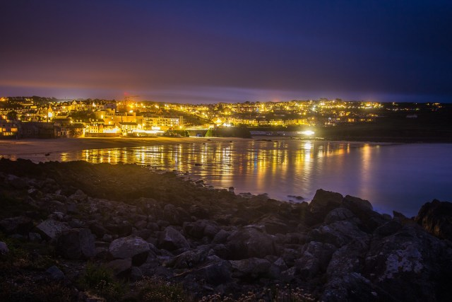 The coast of St. Ives at night with town lights