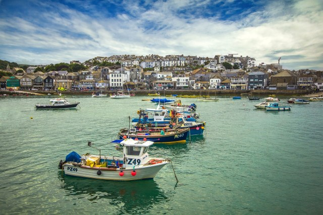 Boats at on water near St Ives waterfront in Cornwall