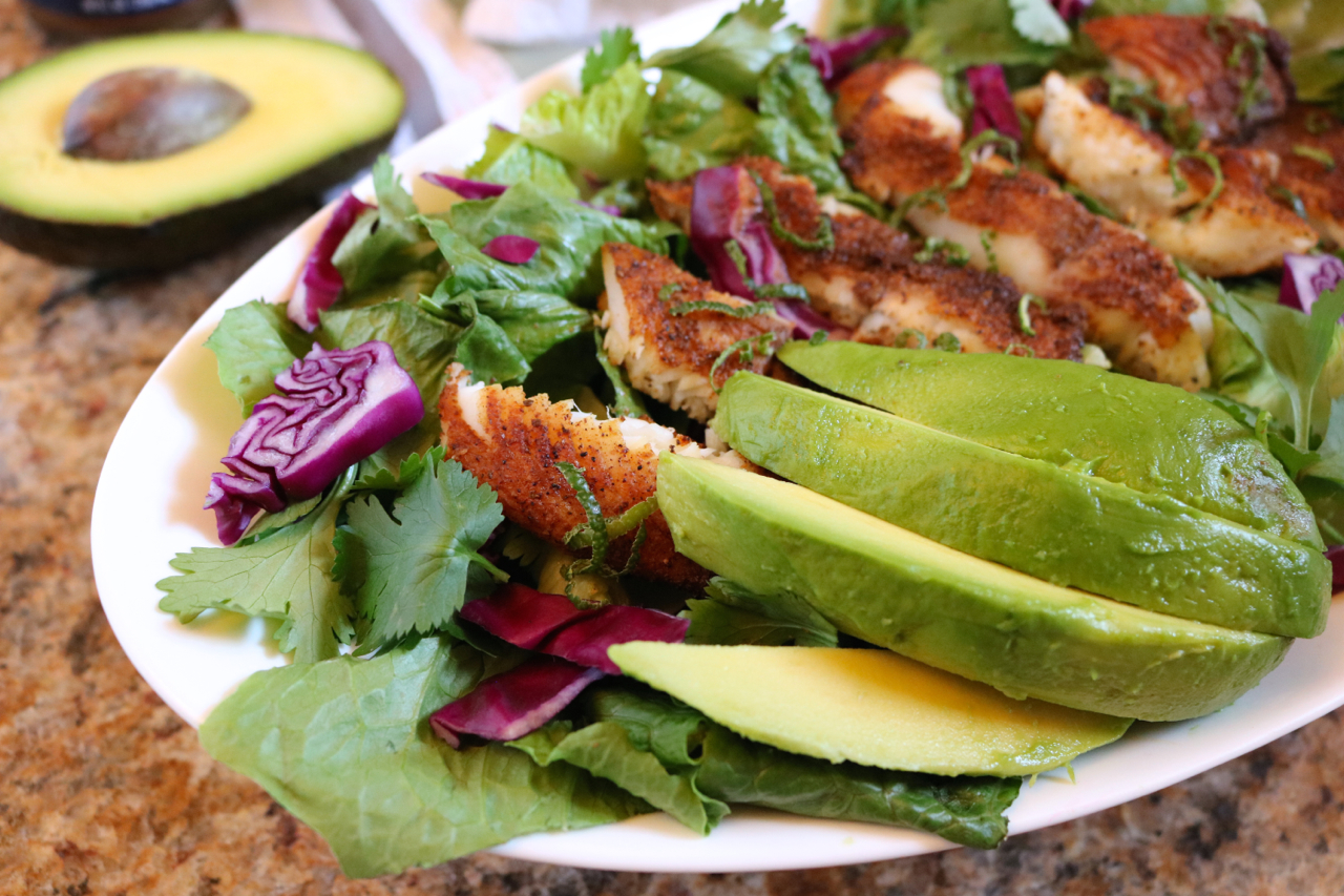 Blackened Tilapia Salad | Inspired by fish tacos, this salad swaps the tortilla with healthy greens for a low carb, paleo friendly dish. | eatsomethingdelicious.com