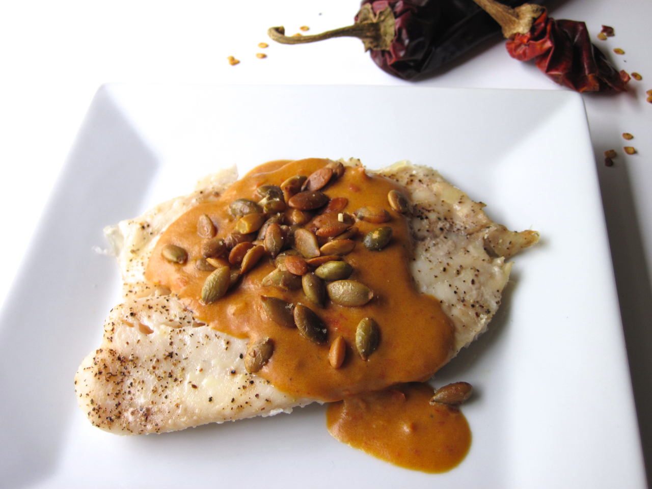 Pumpkin Curry Tilapia | Tilapia topped with toasted pumpkin seeds and pumpkin curry sauce made from homemade curry paste. | eatsomethingdelicious.com
