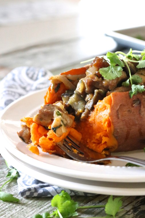 Moroccan Chicken Stuffed Sweet Potatoes | Chicken, apricots, and eggplant seasoned with a unique blend of herbs and spices then stuffed into a baked sweet potato. Paleo with a vegan option. | eatsomethingdelicious.com