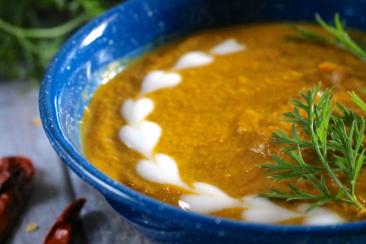 Open Fire Carrot Curry Soup | Spicy carrot curry soup cooked outdoors over an open fire. This soup is vegan, gluten free, and paleo. | eatsomethingdelicious.com