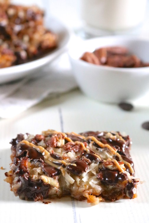 Magic Cookie Bars | An easy version of magic cookie bars made gluten free and dairy free with optional candied nuts and sunbutter drizzle. | eatsomethingdelicious.com