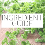 "The words ""ingredient guide"" typed in front of a photo of herbs on a wood surface."