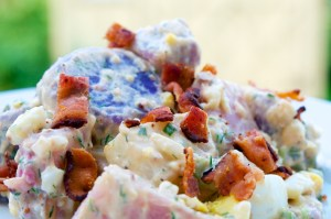 Tri-Colour Potato Salad plated with bacon