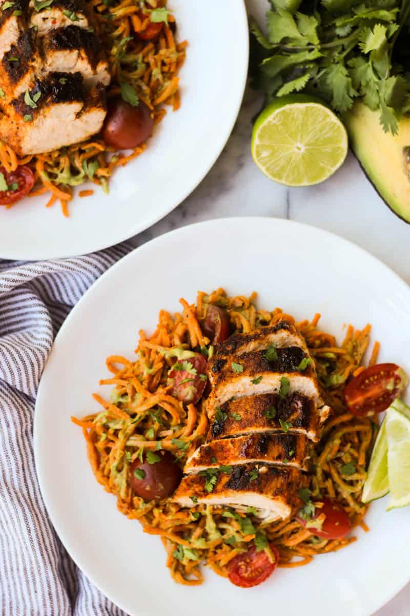 One pan & 30 minutes for thisChili Dusted Chicken & Sweet Potato Noodles with Avocado Sauce. Packed with protein, carbs, and healthy fats to make an easy gluten free, paleo, and Whole30 approved dish - Eat the Gains