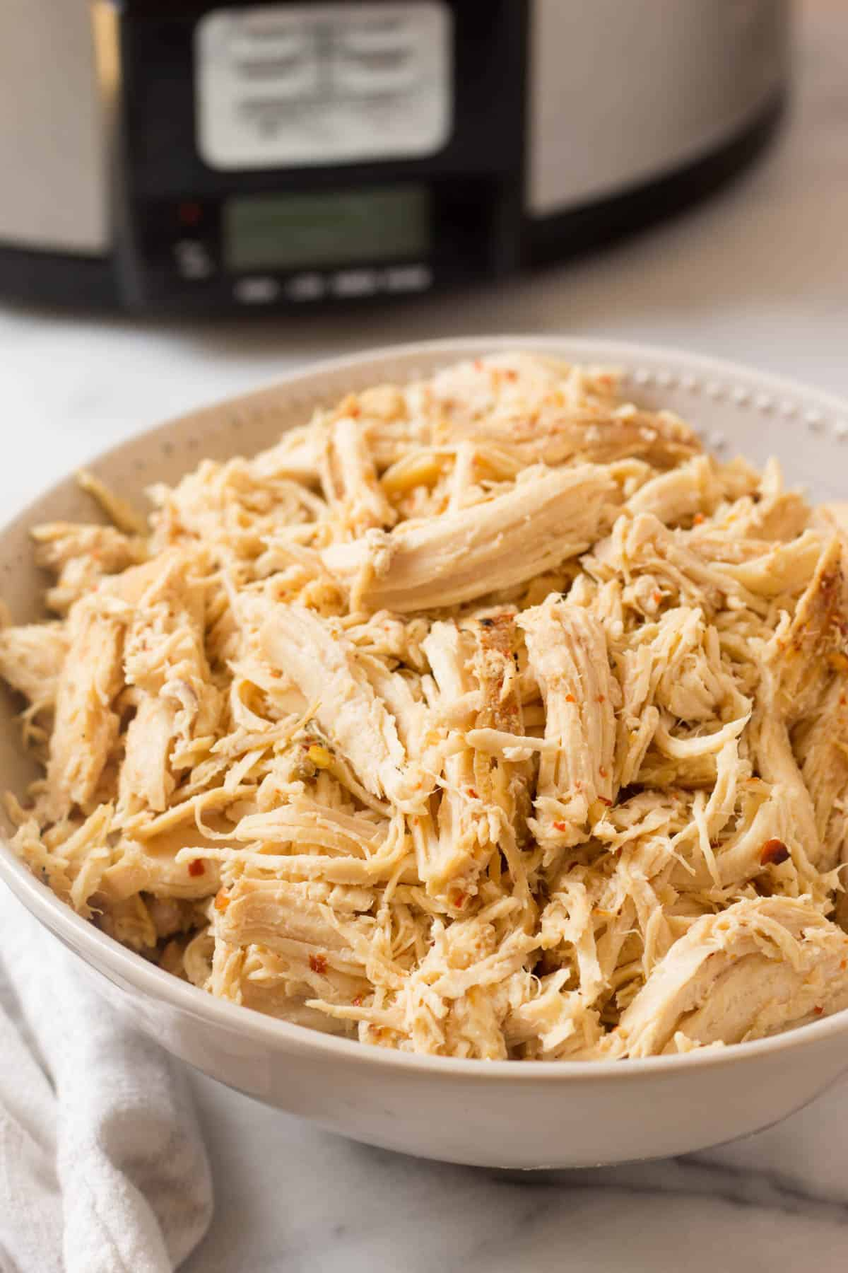 How to make Easy Shredded Chicken 2 ways - in a slow cooker or Instant Pot and only 3ingredients- will be a meal prep staple in your household for easy & healthy protein packed meals - gluten/dairy free, paleo, & Whole30. Plus a free guide on meal prep + 5 different meals to repurpose it throughout the week! - Eat the Gains #mealprep #Whole30 #mealplanning #shreddedchicken