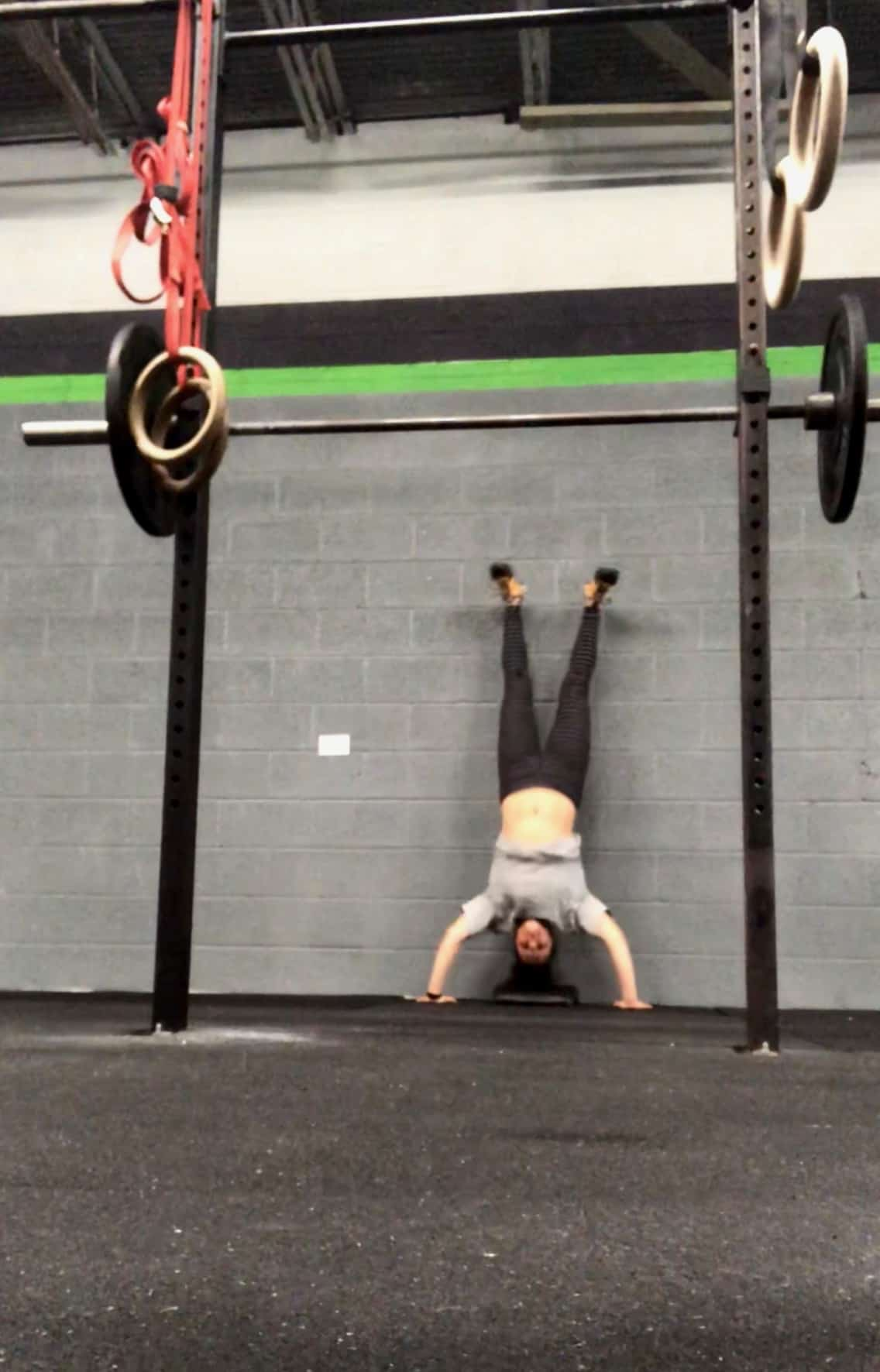 Girl upside-down doing a handstand push-up