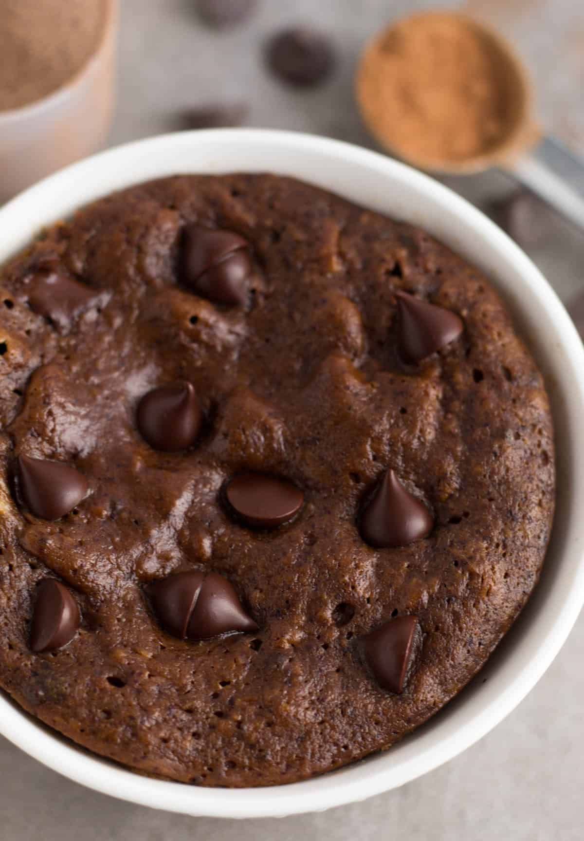Protein chocolate mug cake right after it comes out of the microwave before it is topped with additional toppings