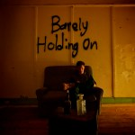 Erik Sing explores the turmoils and insecurities of a relationship in his new collaboration with Sophia Hughes on 'Barely Holding On'