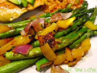 Sautéed asparagus with red and yellow bell pepper and red onion