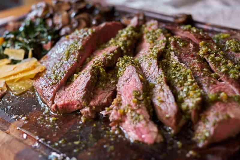 Flank Steak with Chimichurri, sautéed mushrooms and aged gouda.
