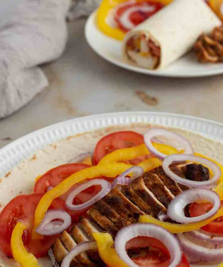 Tortilla wrap loaded with chicken suya and vegetables
