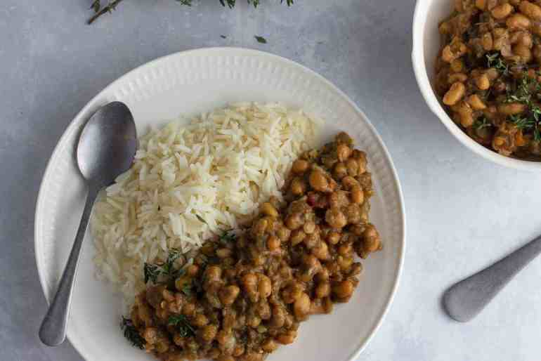 Caribbean curried beans with rice on a white plate