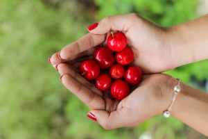 Food woman fruit cherries red green