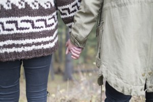 couple-holding-hands-in-forest