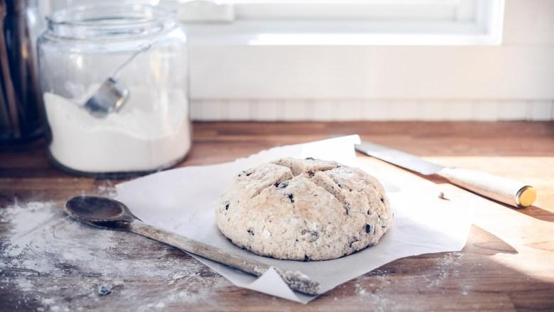 Forming a loaf of vegan Irish Soda Bread.