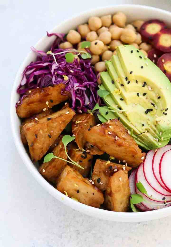 Up close shot of the easy tempeh recipe with cabbage and avocado.
