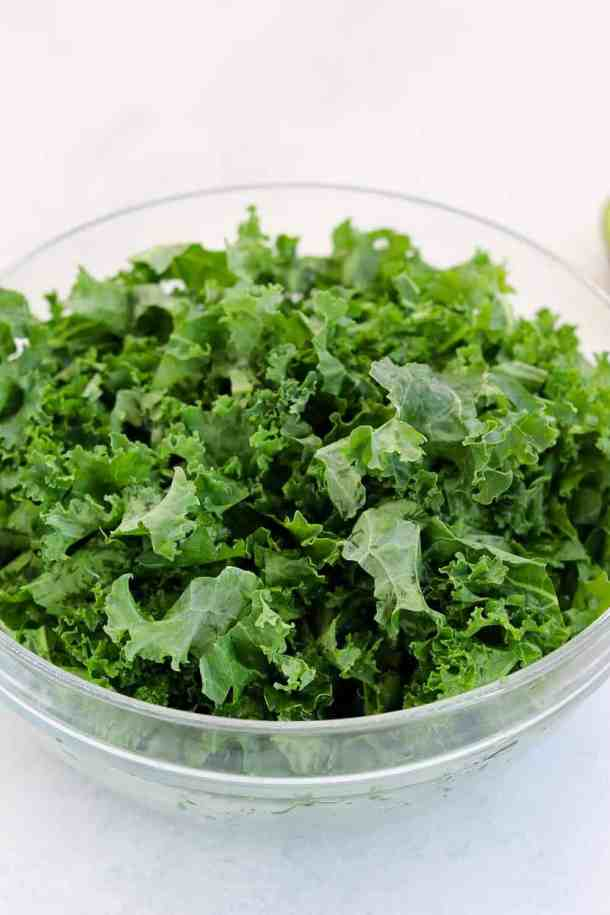 Glass bowl filled with kale.