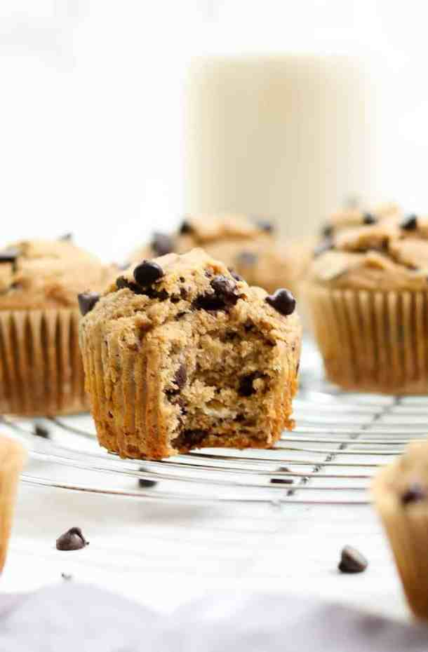 Gluten free banana chocolate chip muffin with one bite taken out.