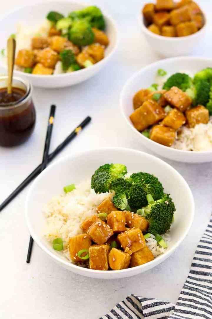 Finished teriyaki tofu recipe in white bowls.
