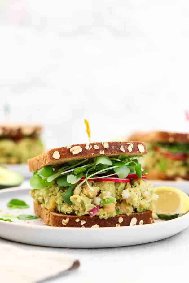Chickpea avocado salad sandwich on a plate.