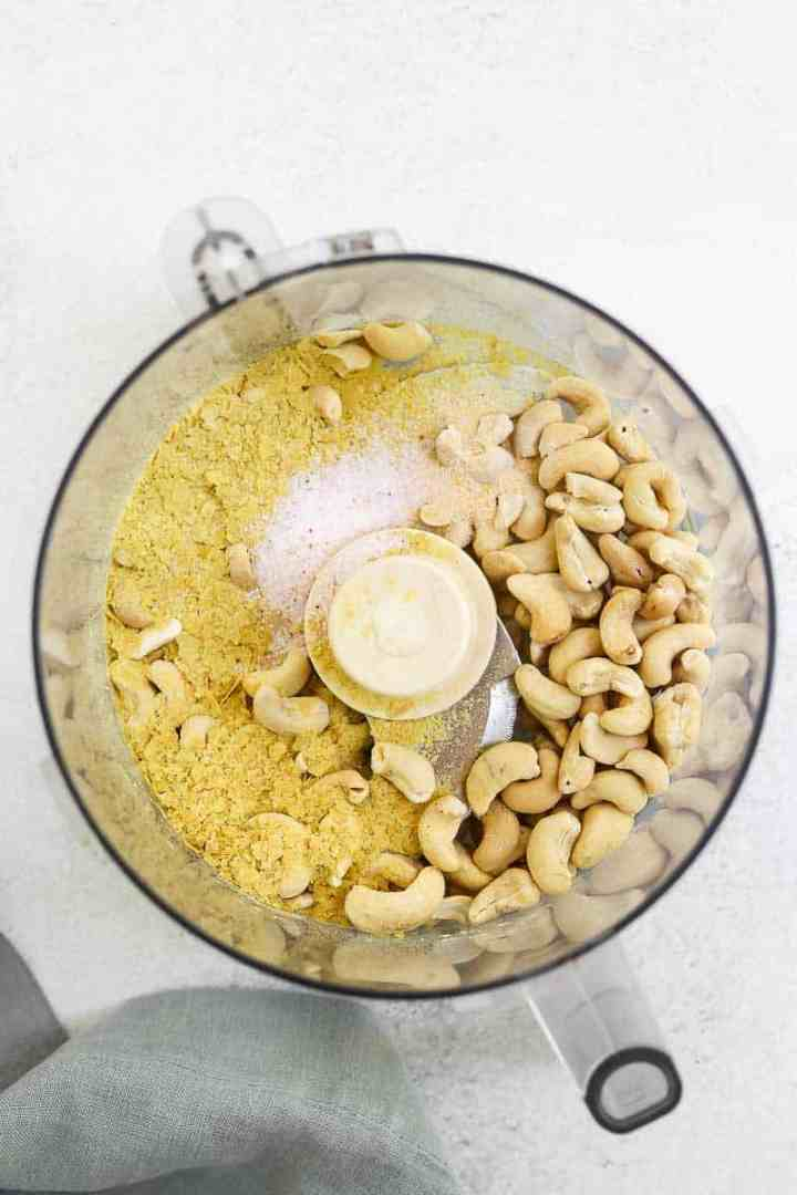Ingredients for the cashew parmesan in a food processor.