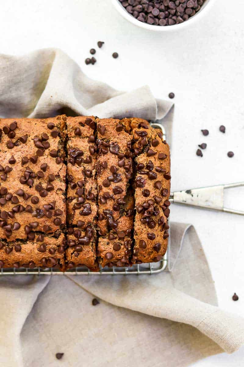 Final banana bread on a cooling rack with chocolate chips.