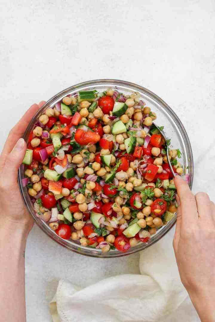 Mediterranean chickpea salad in a large glass bowl.