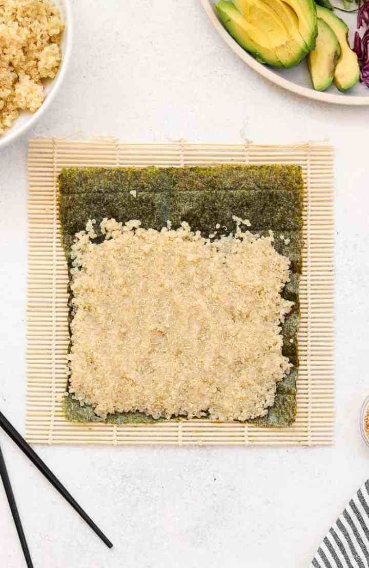 Quinoa and nori on a bamboo mat.