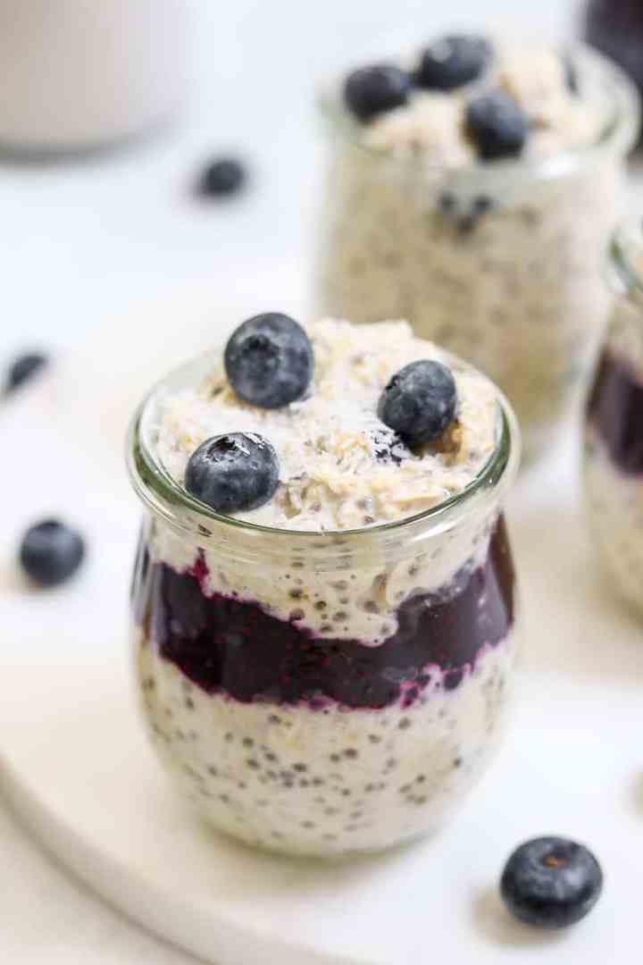 Small weck jar with overnight oats and blueberry chia jam.