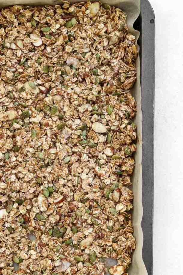 Granola on a baking tray before going in the oven.