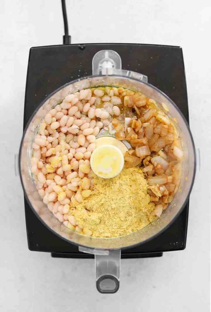 White beans and onion in a food processor.