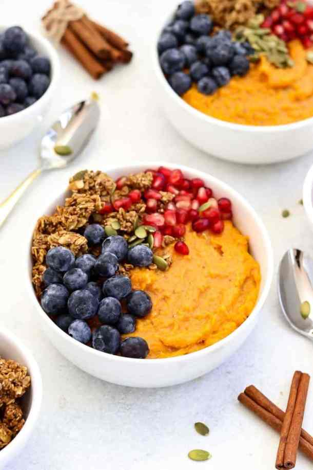 Fluffy sweet potato breakfast bowl with blueberries.