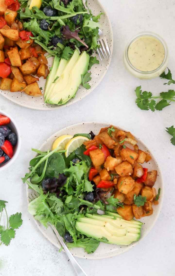 Roasted breakfast potatoes with salad and avocado,