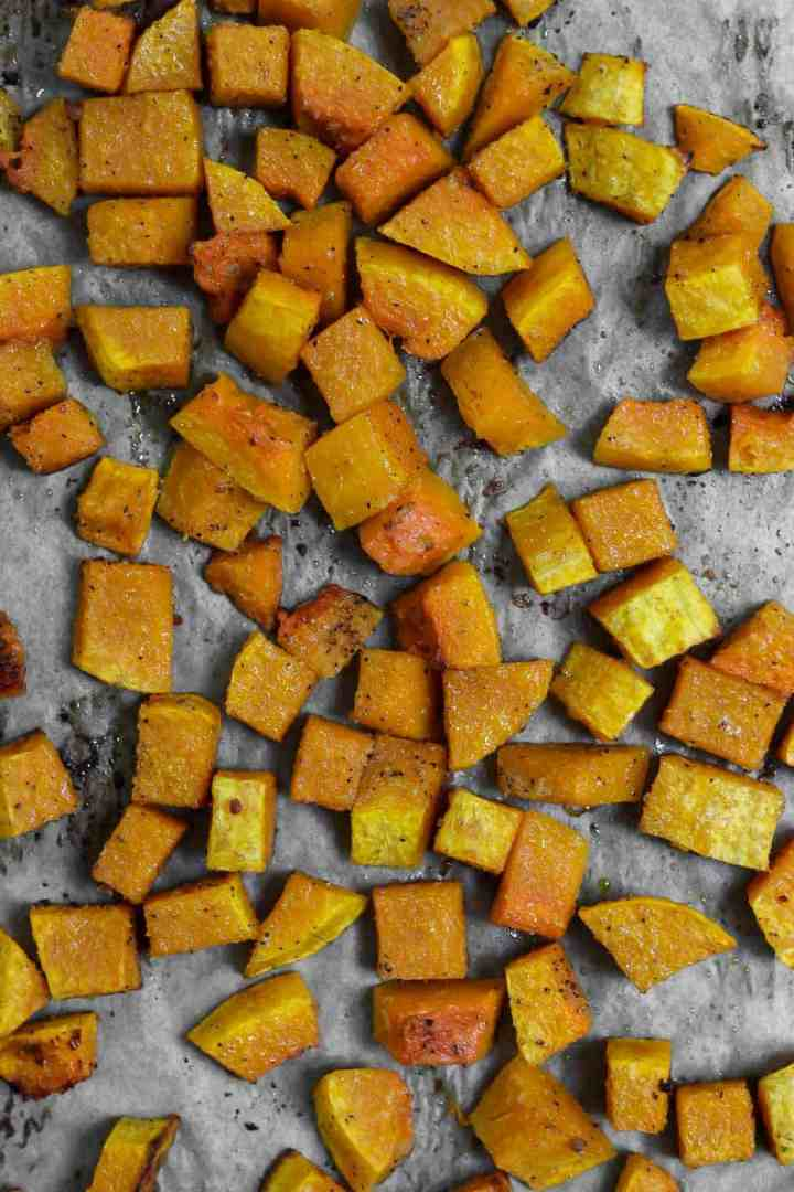 Roasted butternut squash on a baking tray.