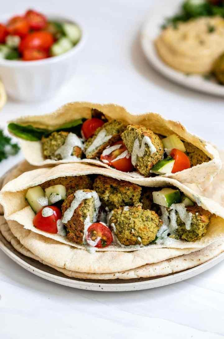 Vegan baked falafel in a pita wrap.